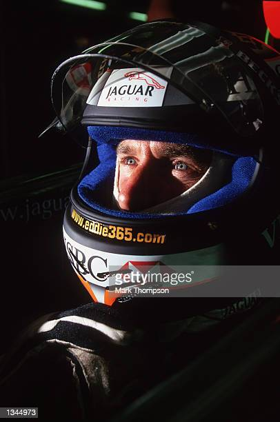 Team Jaguar Driver Eddie Irvine of Northern Ireland relaxes in the garge during the Formula One Hungarian Grand Prix held at the Hungaroring Circuit,...