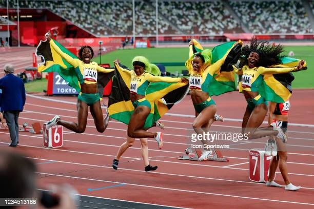 Team Jamaica jump for the cameras during the Women's 4 x 100m Relay Final on Day 14 of the Tokyo 2020 Olympic Games at Olympic Stadium on August 06,...