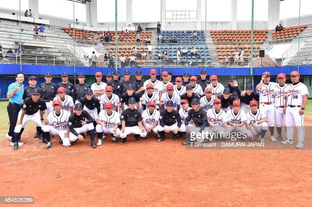 Team Japan and Team China pose for a group photo during the Asian 18U Baseball Championship preliminary game between China and Japan at Baseball...