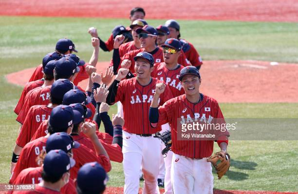 Team Japan celebrate after their 7-4 win against Team Mexico during the baseball opening round Group A game on day eight of the Tokyo 2020 Olympic...