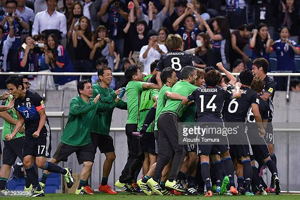 Team Japan celebrate after their second goal during the 2018 FIFA World Cup Qualifiers match between Japan and Iraq at Saitama Stadium on October 6...