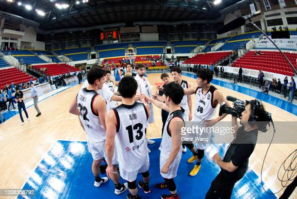 Team Japan celebrate after winning the FIBA Asia Cup qualifier between Chinese Taipei and Japan at the Taipei Heping Basketball Gymnasium on February...