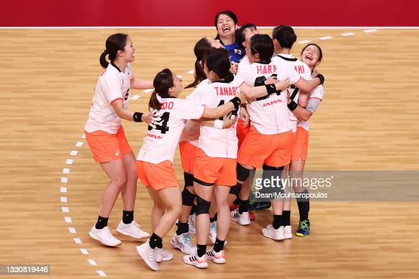 Team Japan celebrate after winning the Woman's Preliminary Round Group A match between Japan and Montenegro on day four of the Tokyo 2020 Olympic...