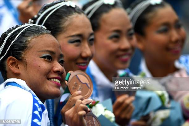 Team Japan celebrate their Bronze Medal in the Synchronised Swimming Free Combination final on day nine of the Budapest 2017 FINA World Championships...