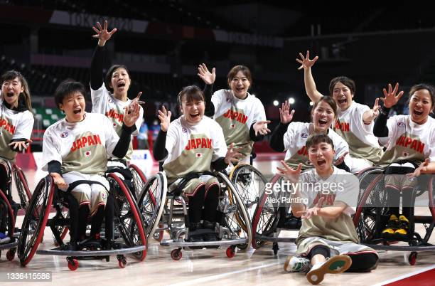 Team Japan celebrate victory during the Wheelchair Basketball Women's preliminary round group A match between team Japan and team Great Britain at...