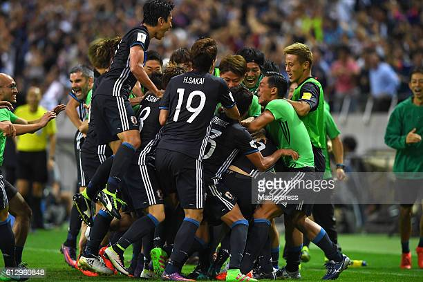 Team Japan celebrates after their second goal during the 2018 FIFA World Cup Qualifiers match between Japan and Iraq at Saitama Stadium on October 6...