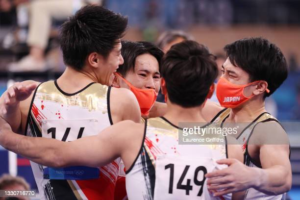 Team Japan celebrates after winning silver during the Men's Team Final on day three of the Tokyo 2020 Olympic Games at Ariake Gymnastics Centre on...