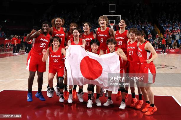 Team Japan celebrates taking the silver medal after the Women's Basketball final game between Team United States and Team Japan on day sixteen of the...
