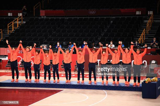 Team Japan celebrates taking the silver medal during the medal ceremony for the Women's Basketball final game between Team United States and Team...