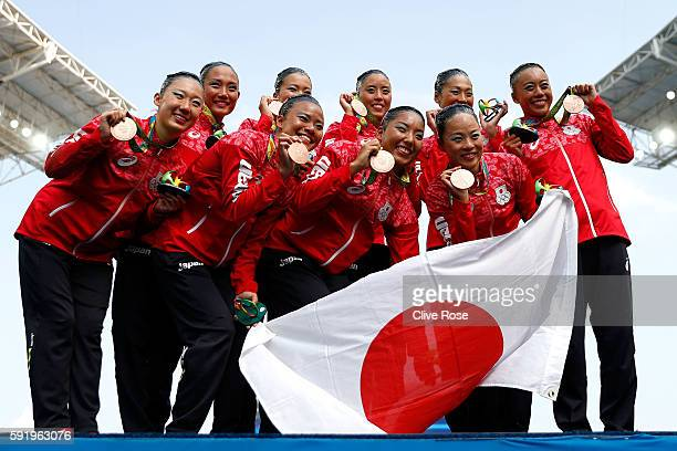 Team Japan celebrates winning bronze on the podium during the medal ceremony for the Synchronised Swimming Teams Free Routine on Day 14 of the Rio...