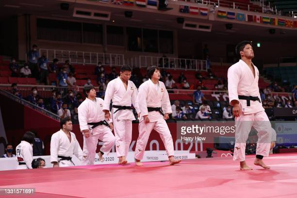Team Japan head out to face the Russian Olympic Committee during the Mixed Team Semifinal of Table A on day eight of the Tokyo 2020 Olympic Games at...