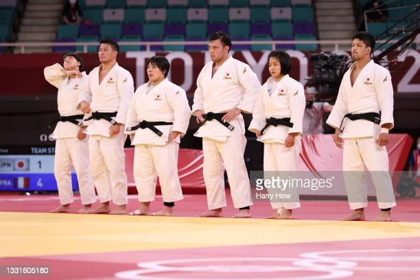 Team Japan look dejected after they were defeated by Team France during the Mixed Team Final on day eight of the Tokyo 2020 Olympic Games at Nippon...