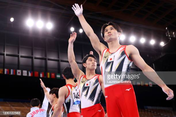 Team Japan looks on during Men's Qualification on day one of the Tokyo 2020 Olympic Games at Ariake Gymnastics Centre on July 24, 2021 in Tokyo,...