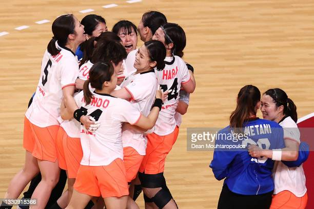 Team Japan players celebrate after winning the Woman's Preliminary Round Group A match between Japan and Montenegro on day four of the Tokyo 2020...