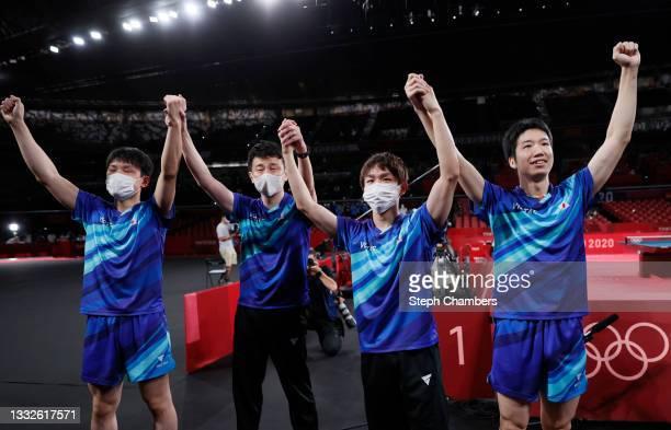 Team Japan players Harimoto Tomokazu , Koki Niwa , Mizutani Jun , and coach Yosuke Kurashima celebrate after winning their Men's Team Bronze Medal...