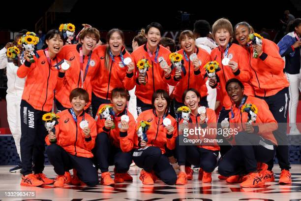 Team Japan pose for photographs with their silver medals during the Women's Basketball medal ceremony on day sixteen of the 2020 Tokyo Olympic games...