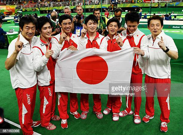 Team Japan poses for photographs after winning the gold medal during the men's team final on Day 3 of the Rio 2016 Olympic Games at the Rio Olympic...