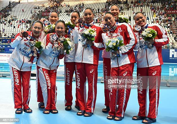 Team Japan poses with the bronze medal during the podium ceremony of the Women's Team Technical final as part of the synchronised swimming...