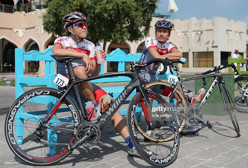 Team Japan riders Kazuhiro Mori and Yuzuru await the start of stage one of the 2013 Tour of Qatar from Katara Cultural Village to Dukhan Beach on February 3, 2013 in Doha, Qatar.
