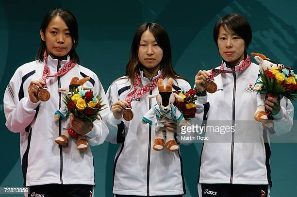 Team Japan wins the bronze medal in the Women's Team Foil Gold Medal match during the 15th Asian Games Doha 2006 at the AlArabi Indoor Hall December...