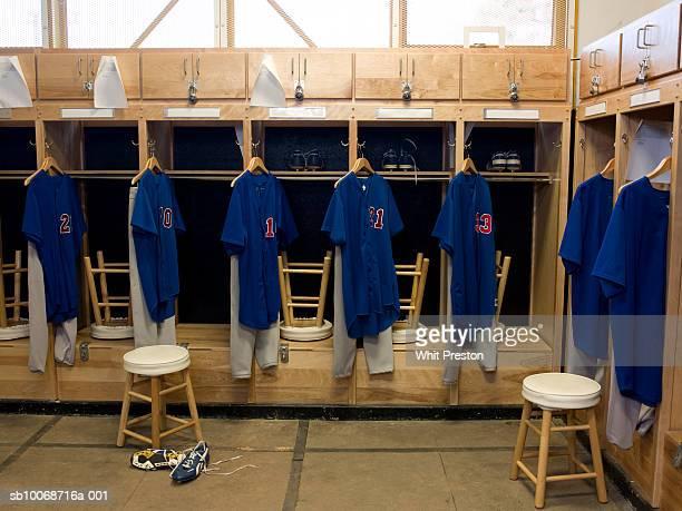 team jerseys hanging in locker room - umkleideraum stock-fotos und bilder