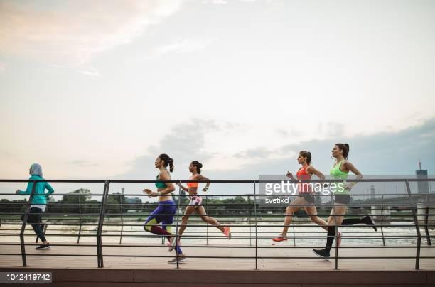 team jogging - marathon stock pictures, royalty-free photos & images