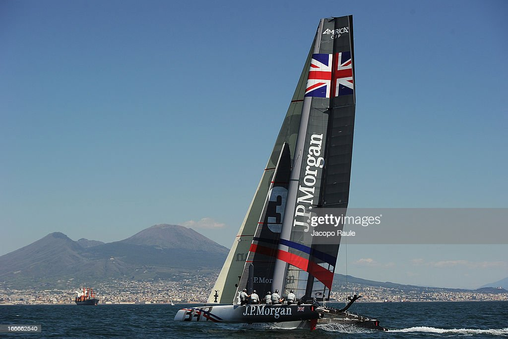 Team J.P. Morgan BAR skippered by British Olympic gold medalist Ben Ainslie sails during a training session in front of Vesuvius ahead of the AC World Series Naples on April 15, 2013 in Naples, Italy.