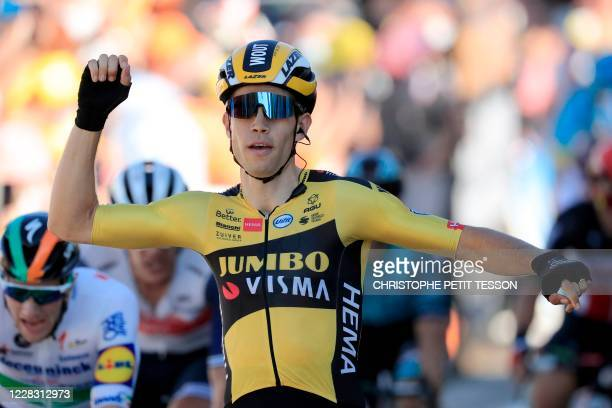 Team Jumbo rider Belgium's Wout van Aert celebrates as he crosses the finish line to win the 5th stage of the 107th edition of the Tour de France...