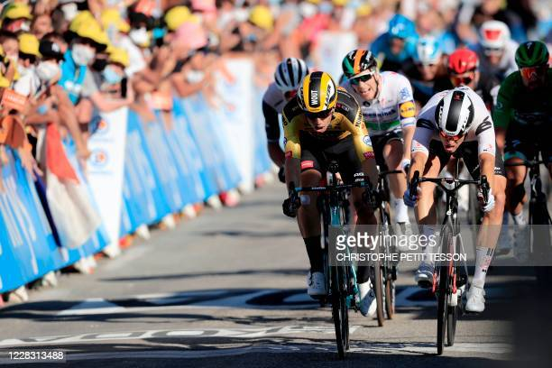 Team Jumbo rider Belgium's Wout van Aert celebrates as he crosses the finish line ahead of Team Sunweb rider Netherlands' Cees Bol at the end of the...