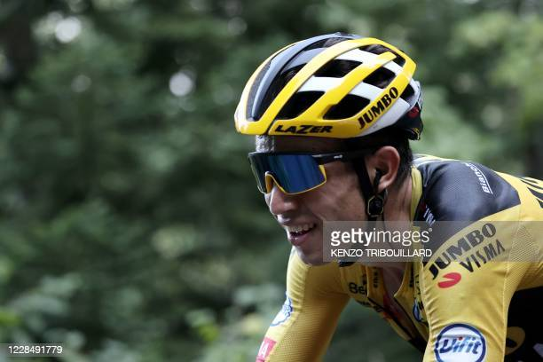 Team Jumbo rider Belgium's Wout van Aert climbs the Grand Colombier pass behind the leader's group during the 15th stage of the 107th edition of the...