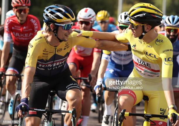 Team Jumbo rider Slovenia's Primoz Roglic and Team UAE Emirates rider Slovenia's Tadej Pogacar wearing the overall leader's yellow jersey attend the...