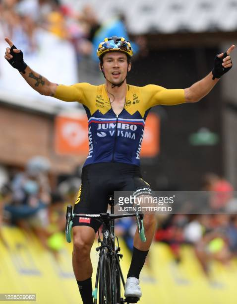 Team Jumbo rider Slovenia's Primoz Roglic celebrates as he crosses the finish line at the end of the second stage of the 72nd edition of the...