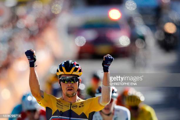 Team Jumbo rider Slovenia's Primoz Roglic celebrates as he crosses the finish line to win the 4th stage of the 107th edition of the Tour de France...