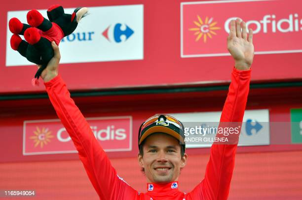 Team Jumbo rider Slovenia's Primoz Roglic celebrates on the podium retaining the leader's red jersey after the eleventh stage of the 2019 La Vuelta...