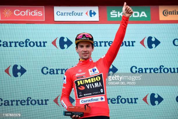 Team Jumbo rider Slovenia's Primoz Roglic celebrates on the podium with the leader's red jersey after the 19th stage of the 2019 La Vuelta cycling...