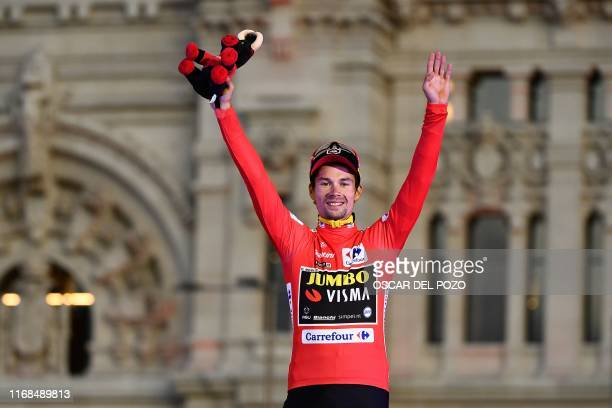 Team Jumbo rider Slovenia's Primoz Roglic celebrates on the podium with the leader's red jersey after winning the 2019 La Vuelta cycling Tour of...
