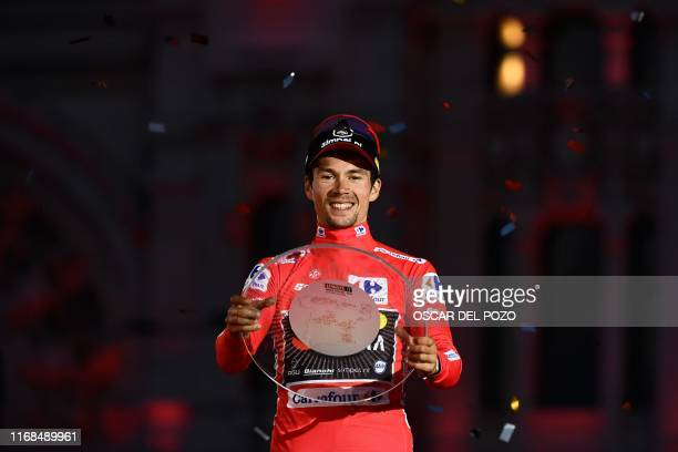 Team Jumbo rider Slovenia's Primoz Roglic celebrates on the podium with the trophy after winning the 2019 La Vuelta cycling Tour of Spain, at the end...
