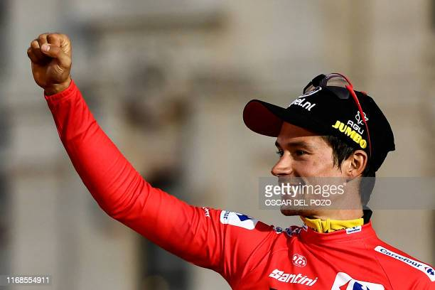 TOPSHOT Team Jumbo rider Slovenia's Primoz Roglic celebrates on the podium after winning the 2019 La Vuelta cycling Tour of Spain at the end of the...
