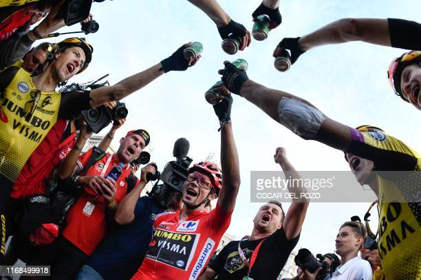 TOPSHOT Team Jumbo rider Slovenia's Primoz Roglic celebrates with his teammates after the 21st and last stage of the 2019 La Vuelta cycling Tour of...