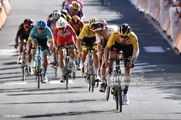 Team Jumbo rider Slovenia's Primoz Roglic crosses the finish line to win the 4th stage of the 107th edition of the Tour de France cycling race, 157...