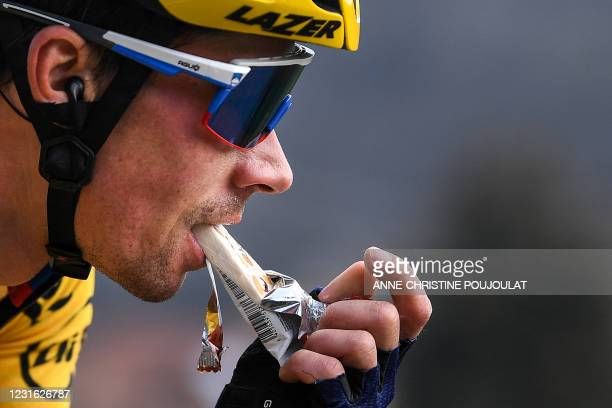 Team Jumbo rider Slovenia's Primoz Roglic eats a snack as he competes during the 4th stage of the 79th Paris - Nice cycling race, 187.5 km between...
