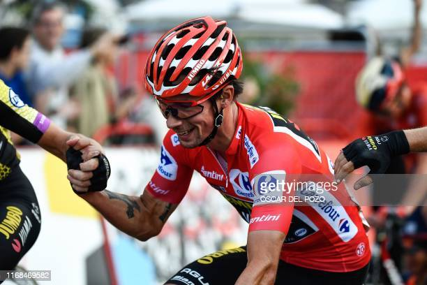 Team Jumbo rider Slovenia's Primoz Roglic is congratulated by teammates at the end of the 21st stage of the 2019 La Vuelta cycling Tour of Spain a...