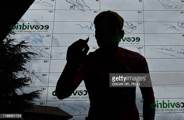 Team Jumbo rider Slovenia's Primoz Roglic signs the board before the start of the 20th stage of the 2019 La Vuelta cycling Tour of Spain, a 190,4 km...