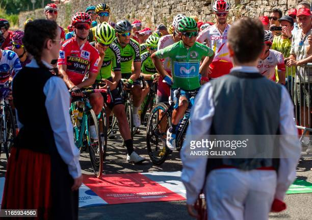Team Jumbo rider Slovenia's Primoz Roglic wearing the leader's red jersey and Team Movistar rider Colombia's Nairo Quintana wearing the best...