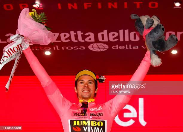 Team Jumbo rider Slovenia's Primoz Roglic, wearing the overall leader's pink jersey, celebrates on the podium after the stage three of the 102nd Giro...
