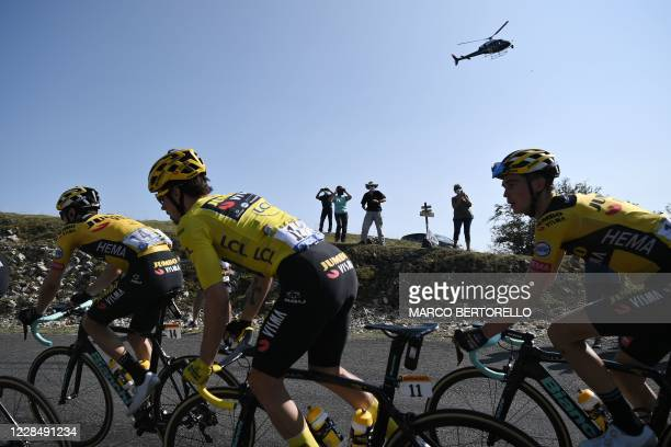 Team Jumbo rider Slovenia's Primoz Roglic wearing the overall leader's yellow jersey climbs Col de la Biche during the 15th stage of the 107th...