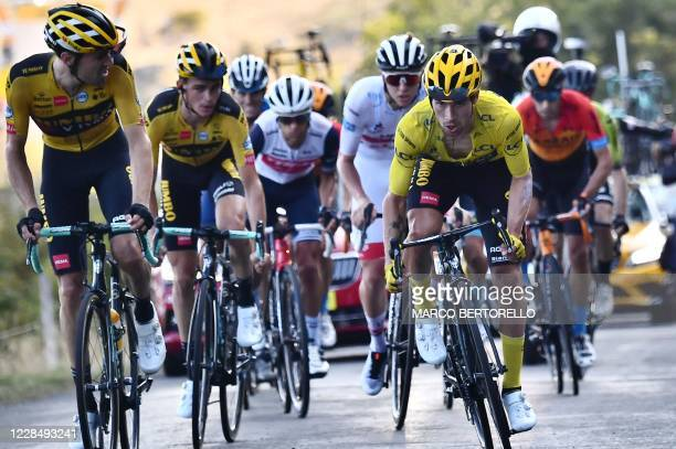 Team Jumbo rider Slovenia's Primoz Roglic wearing the overall leader's yellow jersey climbs the Grand Colombier pass ahead of Team UAE Emirates rider...