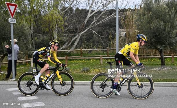 Team Jumbo rider Slovenia's Primoz Roglic wearing the overall leader's yellow jersey and Team Jumbo rider Netherlands' Sam Oomen compete during the...