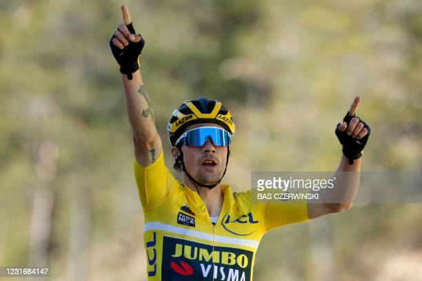 Team Jumbo rider Slovenia's Primoz Roglic wearing the overall leader's yellow jersey celebrates as he crosses the finish line to win the 7th stage of...