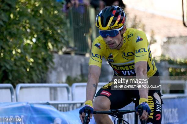 Team Jumbo rider Slovenia's Primoz Roglic wearing the overall leader's yellow jersey crosses the finish line of the 8th stage of the 79th Paris -...